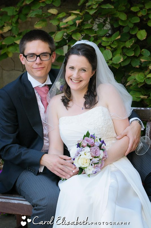 bride and groom on a bench - oxford photography