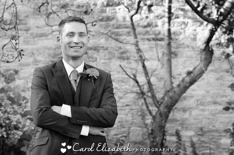 Black and white image of groom before his wedding at The Bay Tree Burford
