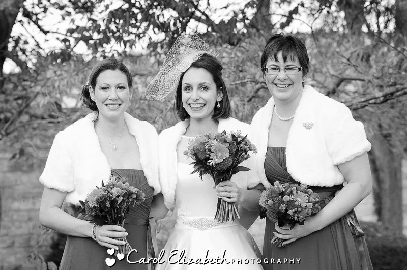Black and white photo at The Bay Tree wedding in Oxfordshire of bride and bridesmaids
