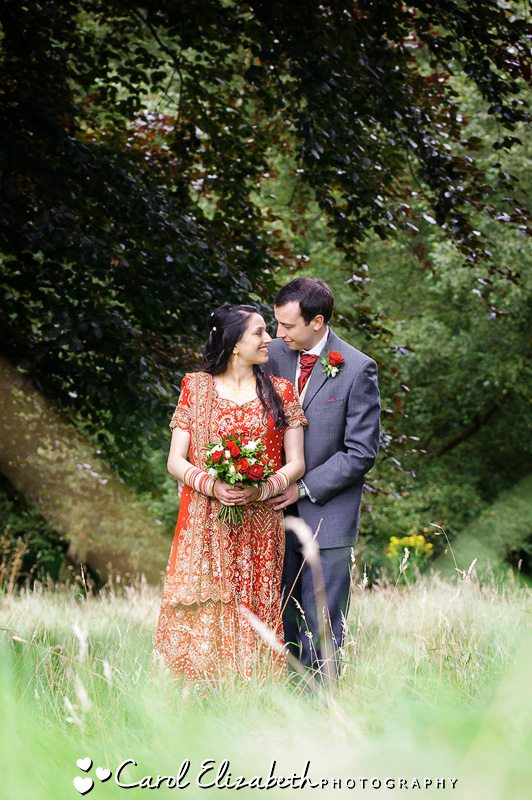Bride and groom by the lake at Heythrop Park wedding