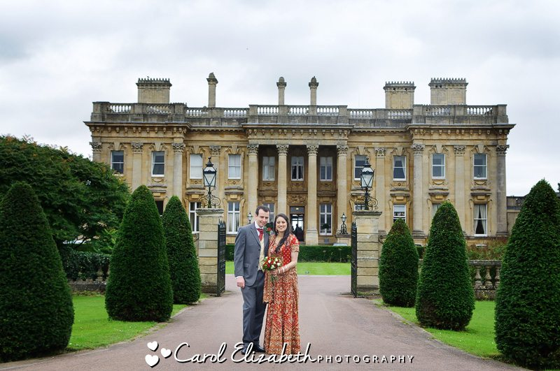 Bride and groom in front of Heythrop Park for their wedding day photography