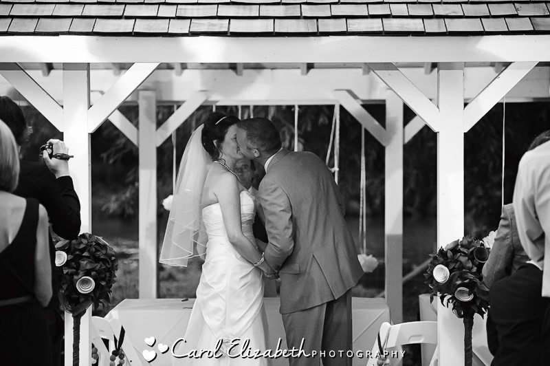 bride and groom kiss monochrome
