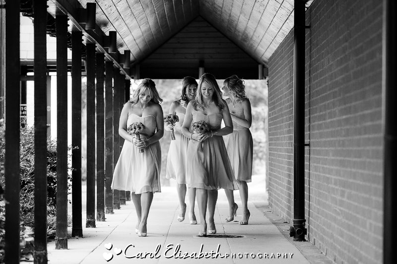 Black and white candid of bridesmaids walking