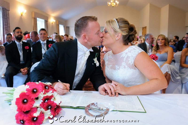 Kissing during signing of register