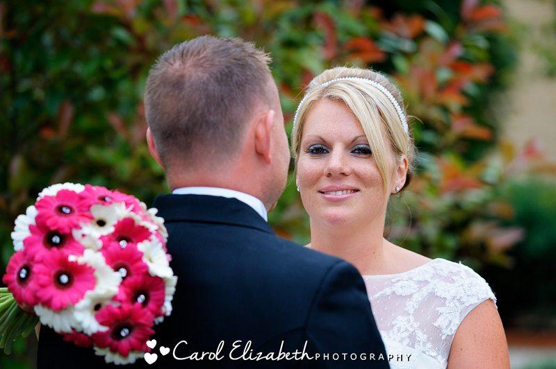 Bride looking over the grooms shoulder