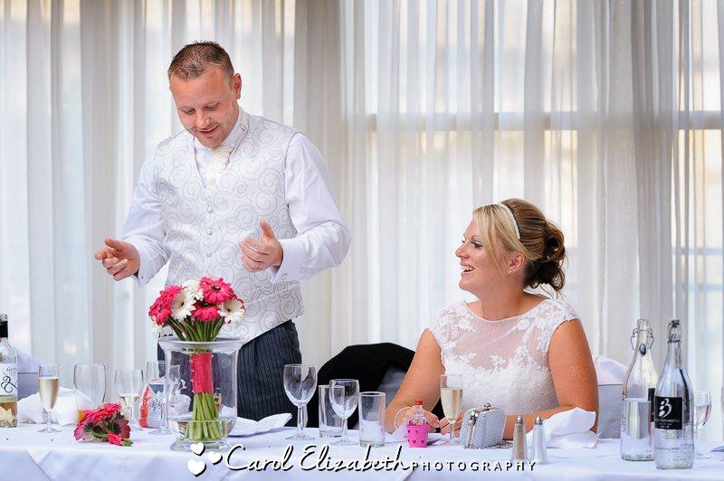 Groom speech as bride looks on
