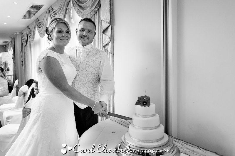 Black and white photo of cake cutting