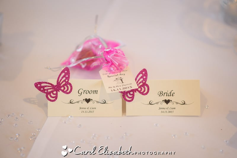 Bride and groom name tags with pink butterflies