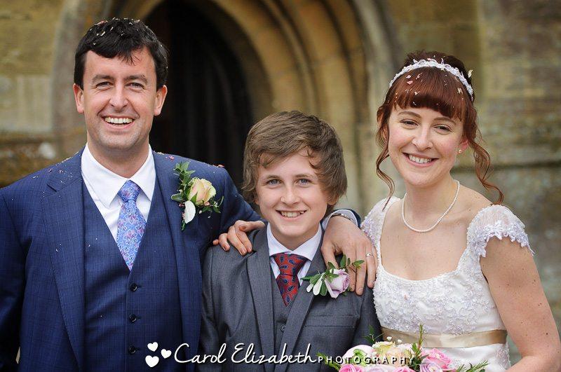 Wedding group photo of bride and groom