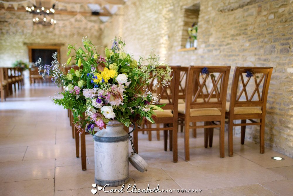 Wedding flowers in urn at Caswell House
