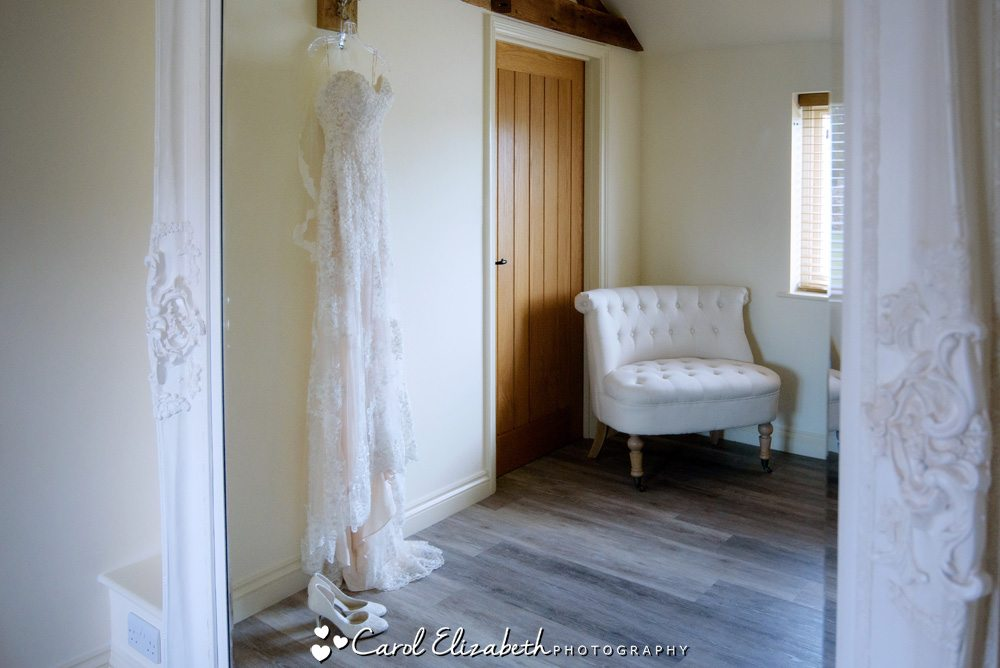 Wedding dress hanging up at Caswell House