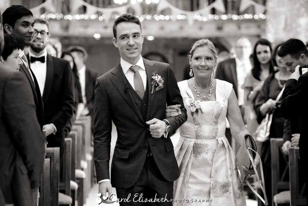 Groom and his mum walking down the aisle