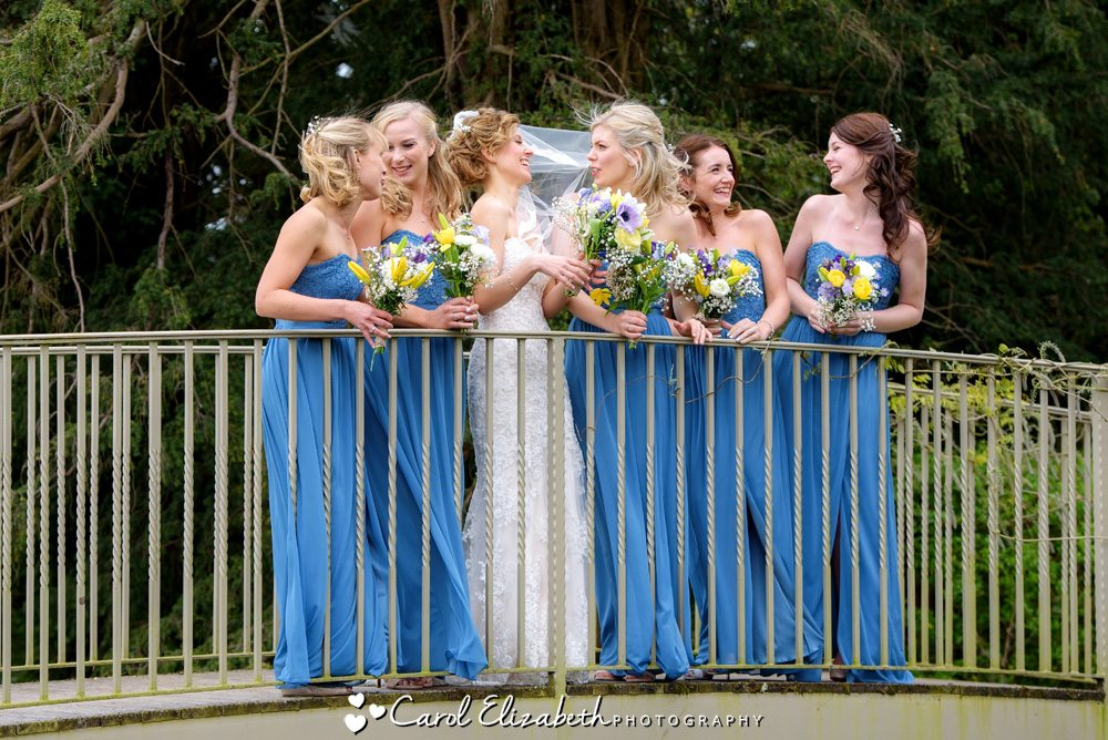 Bridesmaids on the bridge at Caswell House