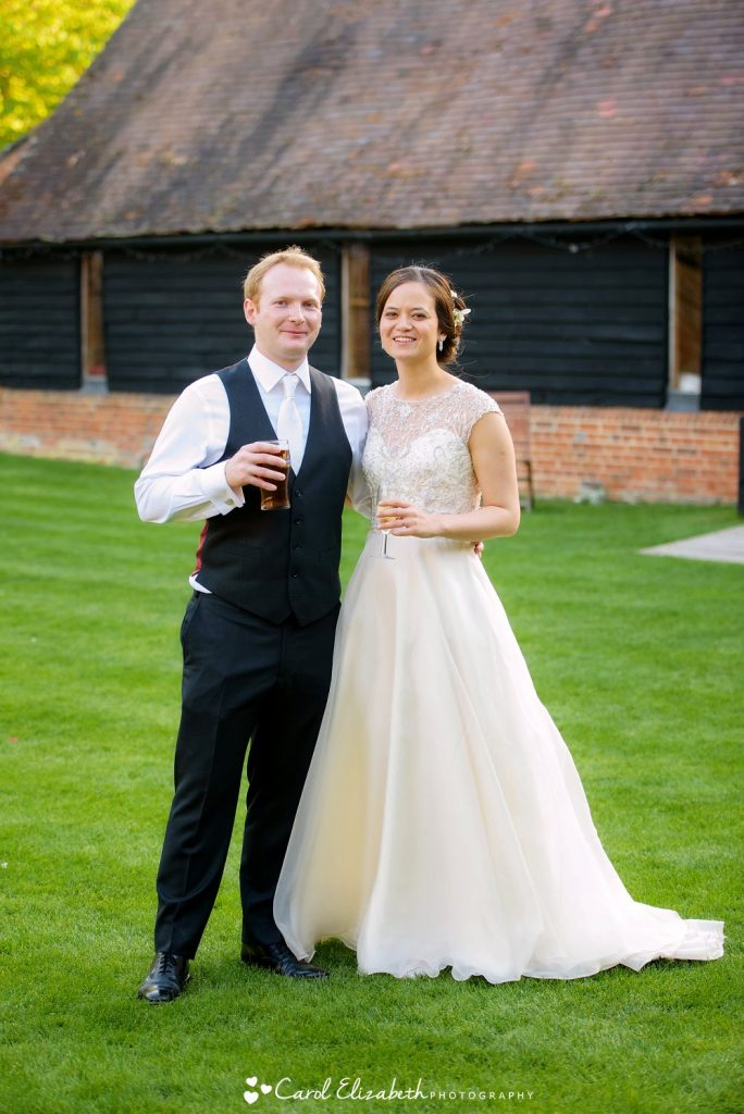 A relaxed photo of the bride and groom after the wedding reception