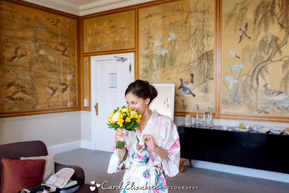 Bride with yellow flowers at Eynsham Hall