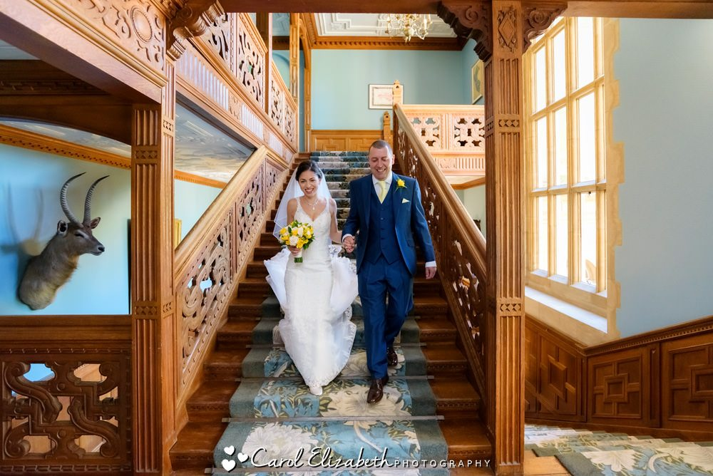 Bride on stairway at Eynsham Hall