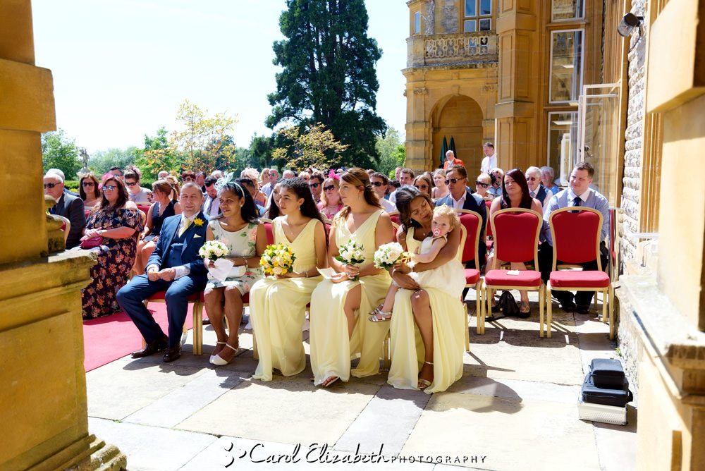 Bridesmaids watching wedding ceremony