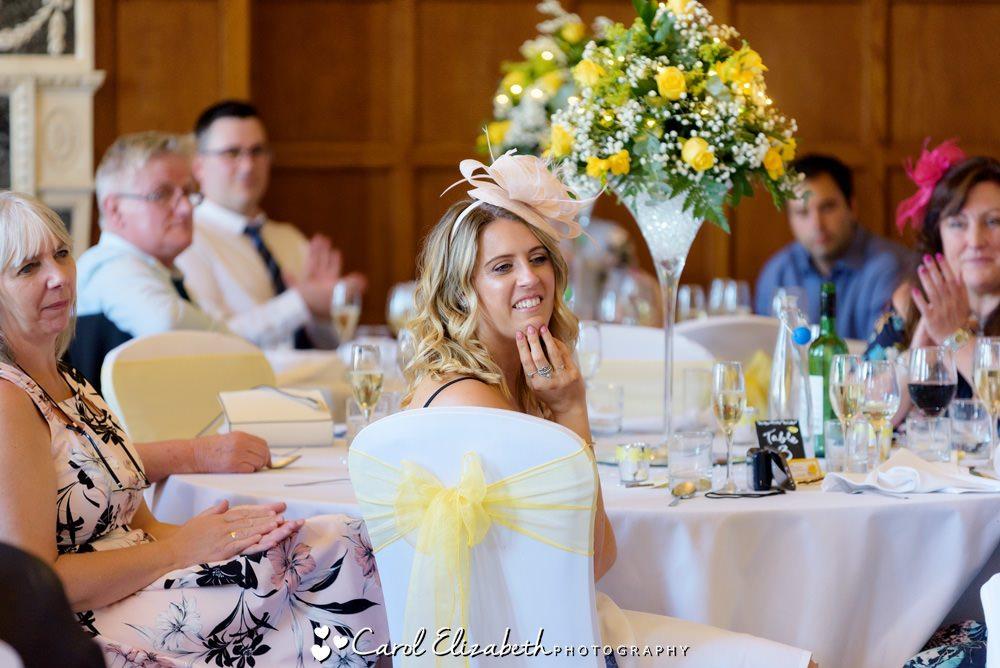 Guests watching wedding speeches