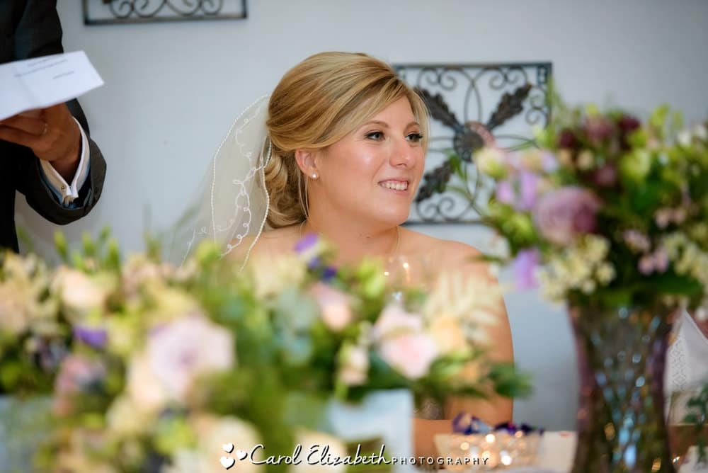 Bride watching speech at Old Luxters wedding