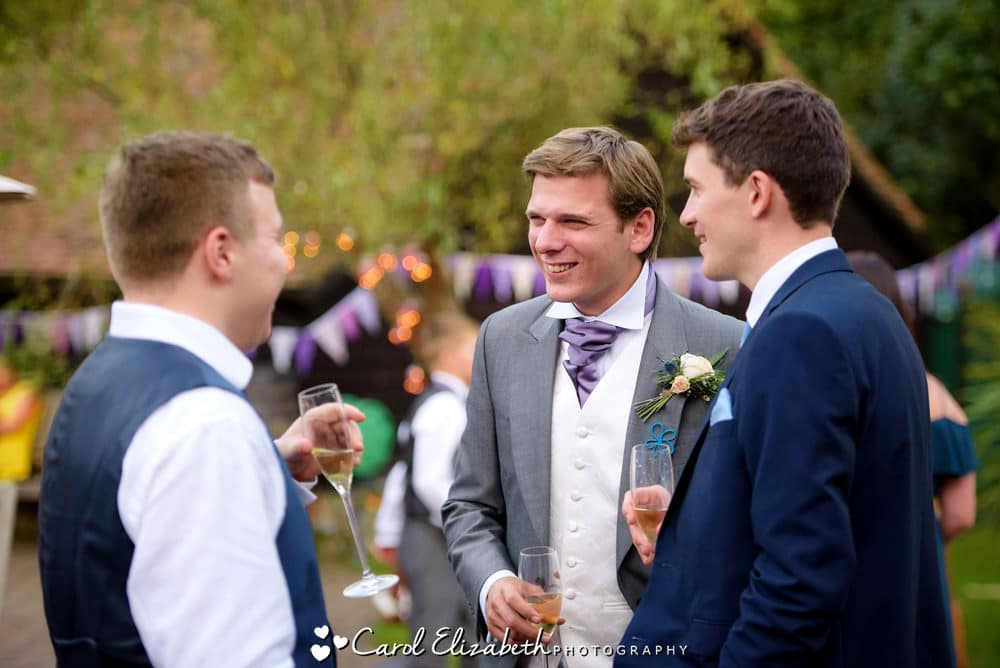 Reportage photo of groom chatting
