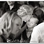 Informal wedding photo of bride kissing boy