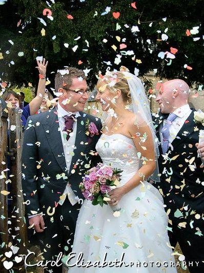 Throwing wedding confetti at wedding in Oxfordshire