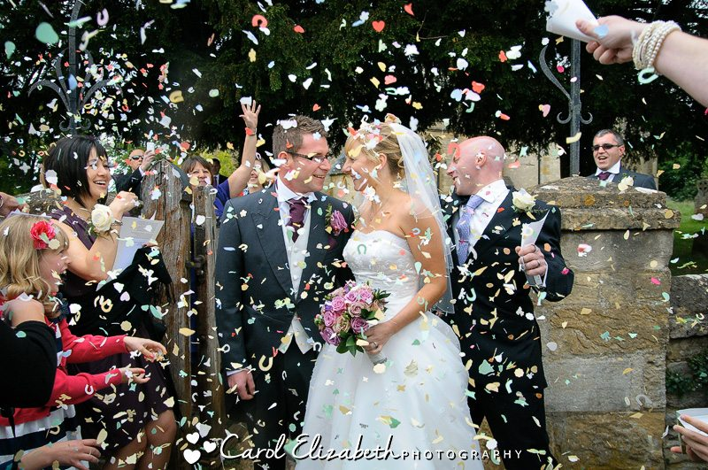 Throwing wedding confetti at wedding in Oxfordshire