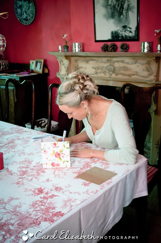 Bride writing before wedding