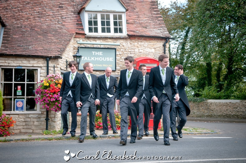 Groom and ushers walking