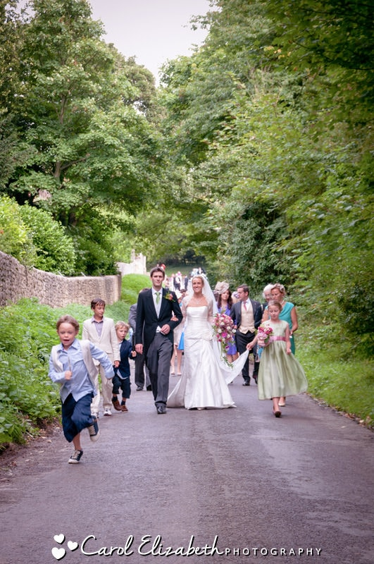 Informal wedding photos of bride and groom walking to reception