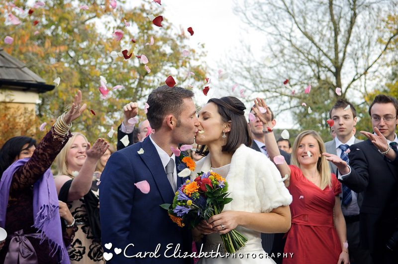 Beautiful rose petal confetti during wedding at The Bay Tree in Burford - natural and informal wedding photography