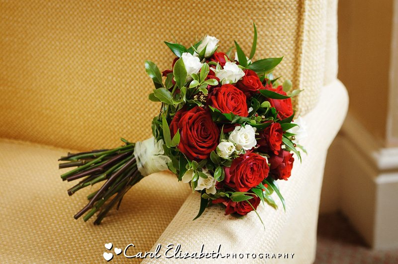 Beautiful red rose bridal bouquet by Oxfordshire wedding photographer