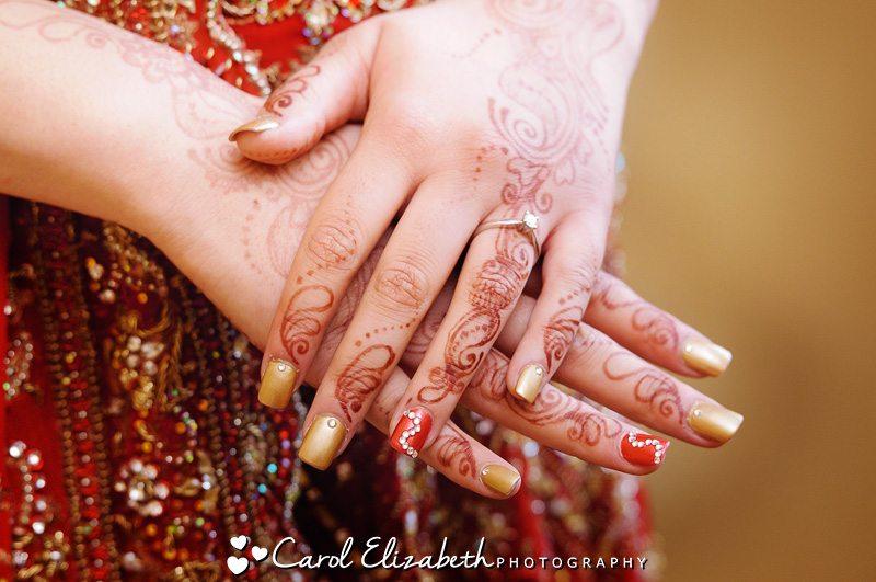 Bride's henna hands with gold nailpolish