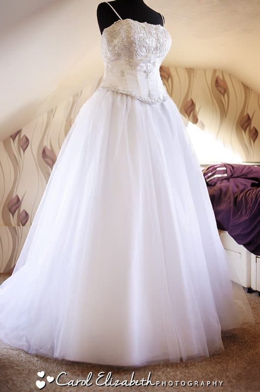 Brides dress hanging up - Hawkwell House weddings in Oxfordshire