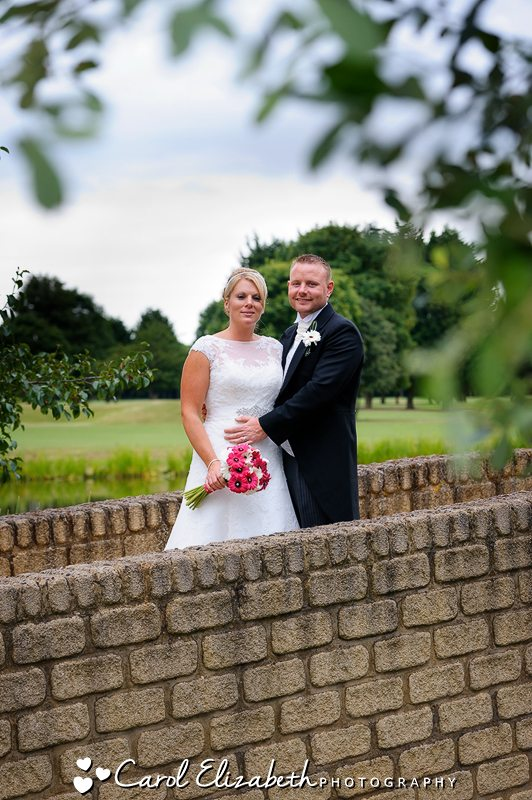 Bride and groom portraits on the golf course