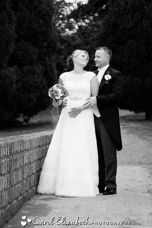 Bride and groom portraits on the golf course - black and white