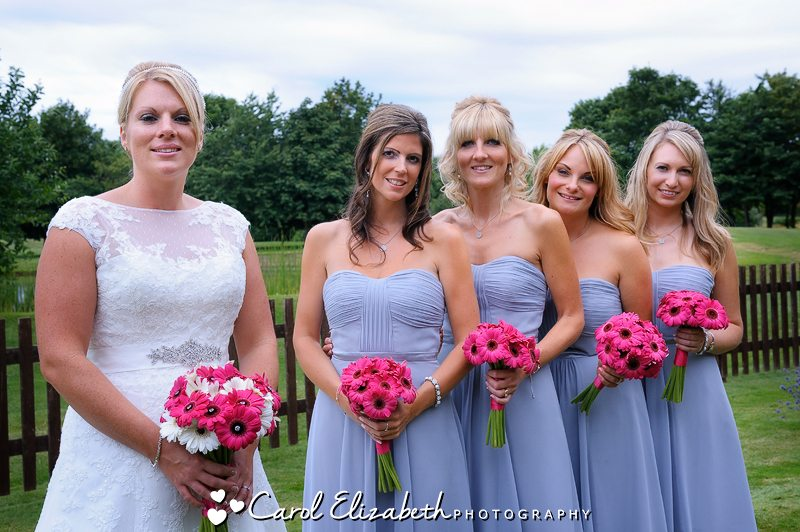 Bride and bridesmaids in lilac dresses