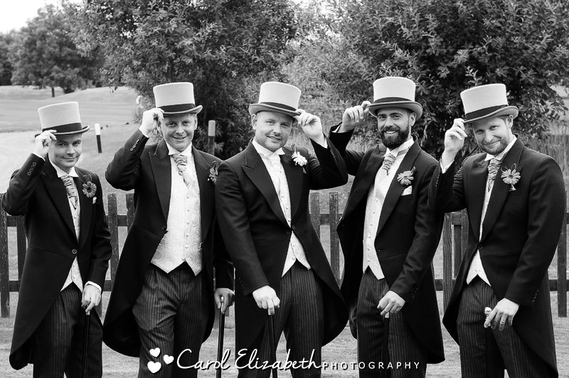 Groom and ushers with top hats