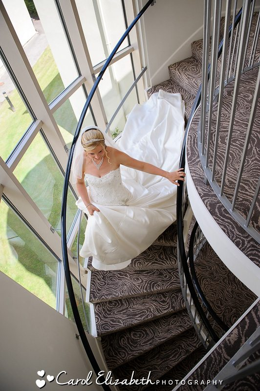 Professional wedding photographer at Sudbury House Hotel - bride on the stairs at Sudbury House