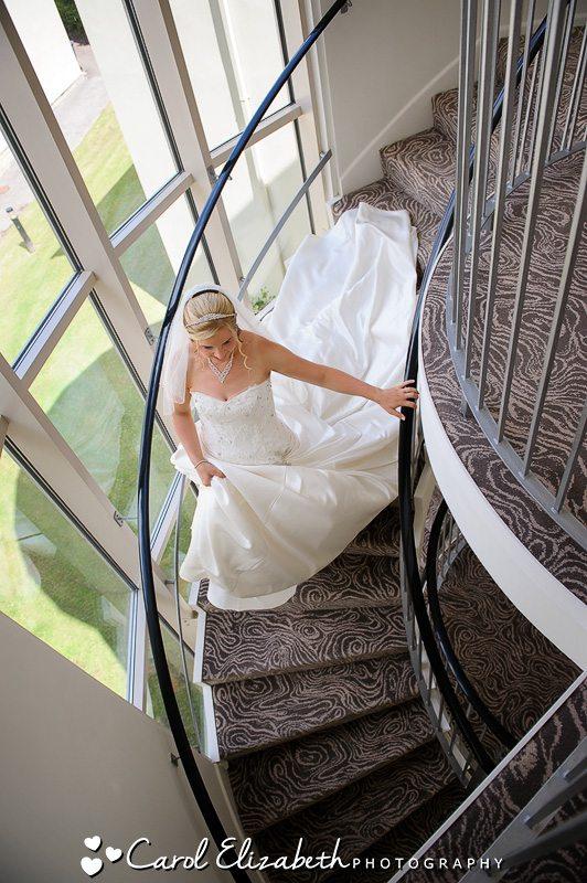 Professional wedding photographer at Sudbury House Hotel - bride on the stairs at Sudbury House