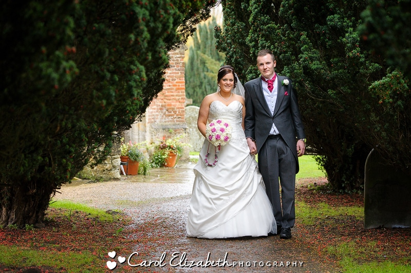 Wedding photography in Oxfordshire - bride and groom leaving church