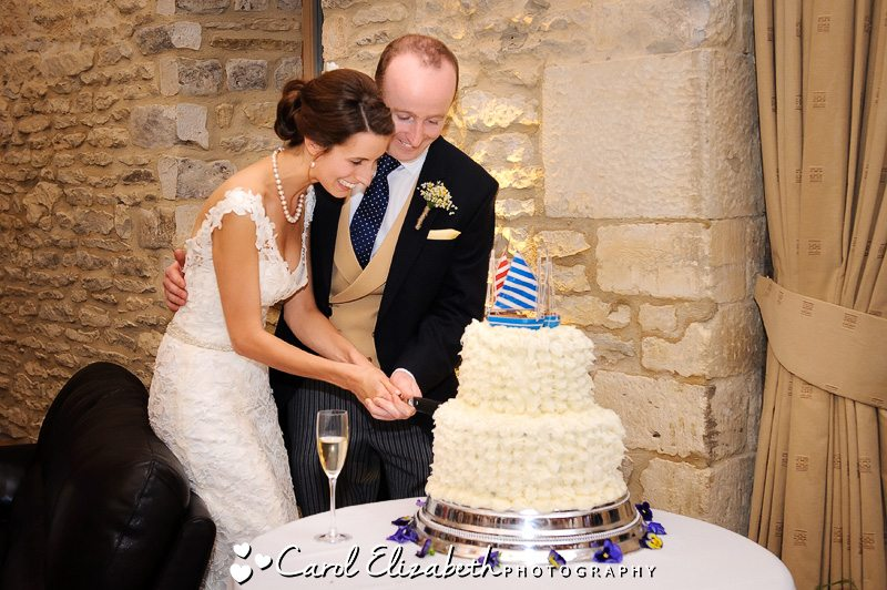 Caswell House cutting wedding cake