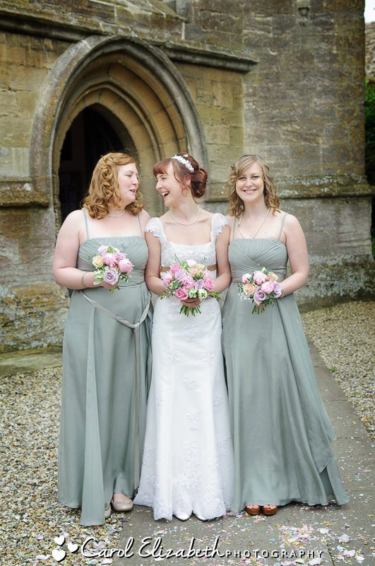 Wedding group photo of bridesmaids and bride