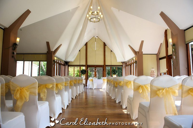 Steventon House wedding ceremony with yellow chair ribbons