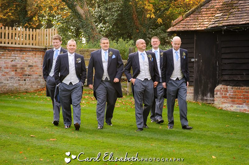 Men walking at wedding in Oxfordshire