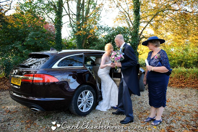 Dad helping bride from the car