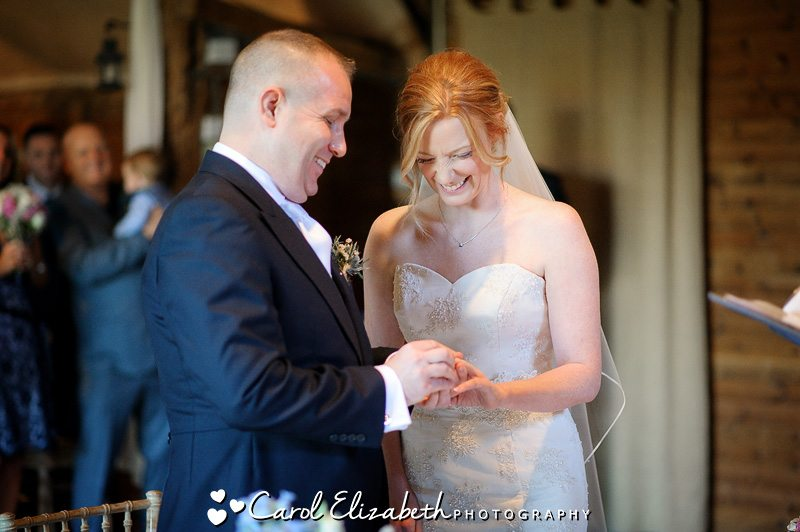 Exchanging wedding rings at Oxfordshire wedding
