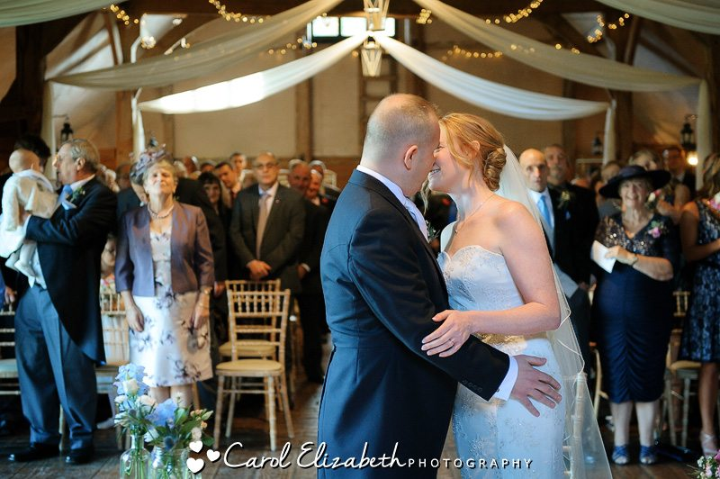 First kiss at Lains Barn wedding in Oxfordshire
