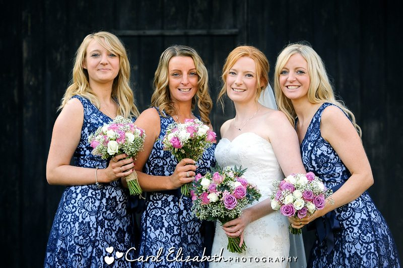 Bridesmaids with blue lace dresses