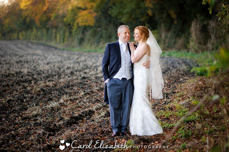Lains Barn weddings - newlyweds in the field in autumn